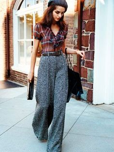 Wide-leg trousers and a shrunken plaid blouse.