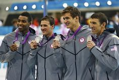 The U.S. men's relay team posing with their silver medals