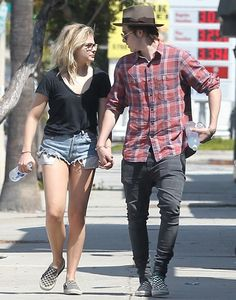 Cute couple Chloe Moretz & Brooklyn Beckham hold hands lovingly and both wearing matching shoes that looking wonderful and pleasing. Chloe Grace Moretz.....