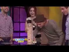 Jamie Campbell Bower, Lily Collins, and Kevin Zegers playing Jenga with the hosts of a Spanish television show.