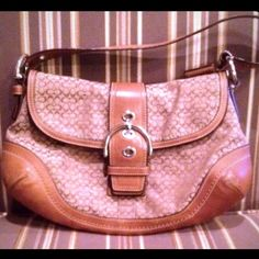 % AUTHENTIC COACH HANDBAG % AUTHENTIC COACH HANDBAG: This GORGEOUS BAG IS GREAT!!! The Signature C Pattern Canvas and warm brown leather, make this bag a GREAT ACCENT PIECE for most any outfit. The inside is in great condition, and has 3 pockets. Outside is in great shape too, with the exception of 1 small discoloration on leather bottom, possibly from the aging of leather, and 1 small ink spot on leather handle. No wear spots, or damage to bag. Any questions? Please ask Coach Bags