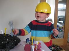hard hats and toy tools at the play-dough table