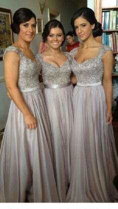 Christmas Wedding: Silver bridesmaids dresses just waiting for gorgeous red and green bouquets!