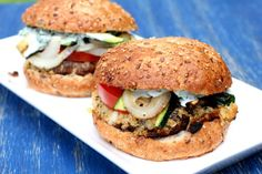 Breaded portabella burgers stuffed with fresh farmer's cheese, caramelized onions, tomatoes, grilled zucchini, and basil mayo. Delicious!