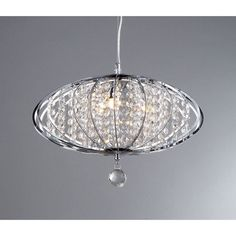This stylish chrome three-light chandelier featured an elegantly modern design. The perfect addition to dining room and hallway decors, this contemporary chandelier showcases rows of cascading crystals to provide stunning illumination.