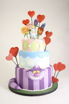 Alice in Wonderland tiered cake by Charm City Cakes
