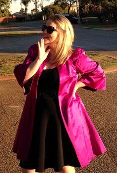 A dramatic coat calls for a dramatic pose. Wearing a Prada knit dress, Peter Som silk coat, L'Wren Scott sunglasses and Valentino Shoes. June 2014. #Prada #PeterSom #LWrenScott #Valentino http://www.bargainsandbeautiful.com/a-winter-wedding/