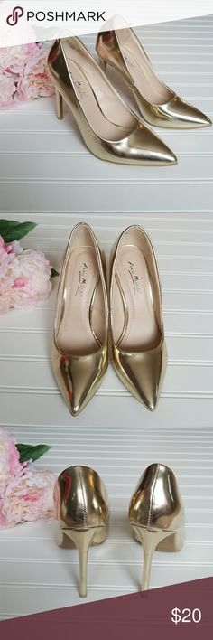 "Anne Michelle gold metallic high heels size 6.5 Anne Michelle women's gold metallic 4"" high heels .In great condition worn once . Anne Michelle Shoes Heels"