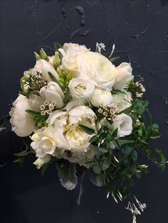 Stunning Bridal bouquet with peonies, white tulips, jasmine, veronica, genista, lisianthus, freesia and silver leaves.