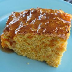 The sweet potatoes give this corn bread a delicious twist, and helps make it moist. It is wonderful served with the cinnamon butter while still warm.