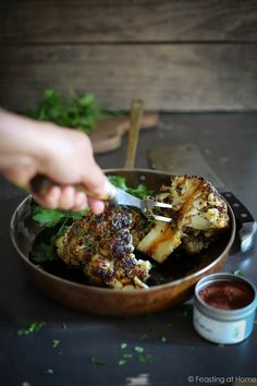 Feasting at Home: Whole Roasted Cauliflower with Black Tahini and Sumac