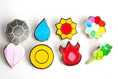 Complete set of 8 Gold OR Silver Kanto Gym Leader Badges Lapel Pins from Pokemon Series 1. Free Shipping to the UK