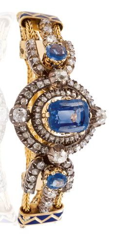 LOUIS CARTIER - A VERY RARE AND ELEGANT ANTIQUE GOLD, SILVER, ENAMEL, SAPPHIRE AND DIAMOND BRACELET, CIRCA 1890. Centring one blue cushion-shaped sapphire highlighted by rose-cut diamonds. The two textured chain bracelet connected by four yellow gold and enamel flat ring motifs connected to silver and yellow-gold diamond links motifs highlighted with two blue sapphires. With maker's mark LC for Louis Cartier.