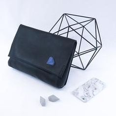 GAMENT 3D Printed Diamonds and Rocks on a Black Leather Clutch with Marbled Phone Case   #Diamonds #3D #Gemology