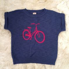 """NWOT Mossimo Supply Bicycle Print Sweater Top XS NWOT. Adorable bicycle print dolman sweater by Mossimo Supply Co. Blue and bright pink. Short sleeves with ribbed hem and neck. Size XS. Oversized fit. Measurements when laid flat: bust 19"""", waist 17.5"""", front length 21"""" from shoulder. Sleeve length 8.5"""" from neckline. Made of 100% cotton. Soft and stretchy. Medium weight. Cute with denim shorts or a lace skirt for spring. ✖️No trade. No PayPal.✖️No low offers. Mossimo Supply Co. Sweaters"""