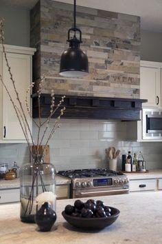 Interior design -ed by Carla Aston, interior designer / Photography by Tori Aston | Home kitchen renovation-remodel-makeover; rustic, coffee house style; stove; backsplash; granite countertop; hood; cabinet.