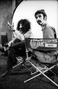 """Mike Nesmith and Frank Zappa impersonating each other.  Mike is giving a one-finger salute (a """"Loose Salute""""?), as well."""