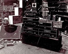 """David Gilmour's rig being set up at Earls Court for """"The Wall"""" circa 1980. Note the Schaffer-Vega wireless receivers ready for DG during his solo on top of the wall,"""