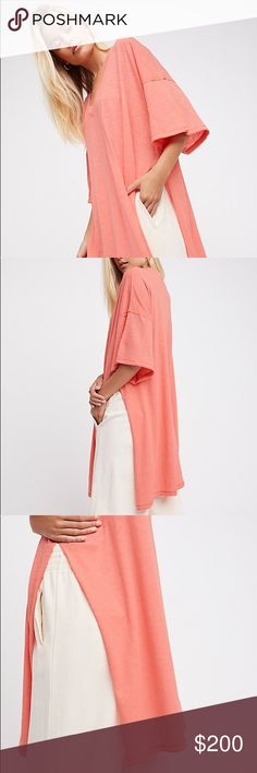 COMING SOON We The Free Solid City Slicker Tunic This is an amazing tunic that is a top rated item from free people. The slit detailing makes this tunic. It has a distressed look and is great for a dress-down look for running errands on the weekends. Free People Tops Tunics