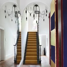 Gold Carpet Stair Runner in Stair Carpet Runner Ideas. Modern hallway with contemporary decoration scheme, unusual chandelier and bold mustard carpet stair runner. Painted Stairs, Wooden Stairs, Black Stairs, Dark Staircase, Hallway Inspiration, Interior And Exterior, Interior Design, Interior Ideas, Hallway Designs