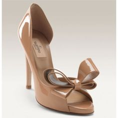 VALENTINO Cream Patent Leather Bow Stilettos Valentino Couture Bow Pumps are the ideal heel to complete your wardrobe & luxurious style. Impress in timeless Valentino tan leg-lengthening heels. Made in Italy. Leather lining, bow details, patentleather design. Goes w/anything: casual, dressy, wear day-night for all seasons! Bought at Sacks Fifth Avenue NYC. I'm comp. giving 2 Salvatore Ferragamo shoe garment bags! Sz 37.5=7-7.5 comes w/back pads. More pics / Only💰$280 Ⓜ️ercari & Tradesy…