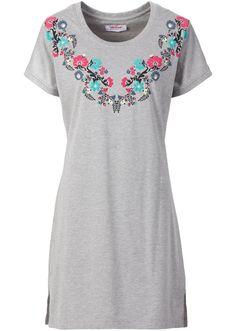 Veja agora:Perfeita para quem gosta de vestir camisetas como saída de praia. Camiseta manga curta com decote redondo, de comprimento médio, com estampa frontal de flores. Perfeita para ir à praia ou para um passeio despretencioso.