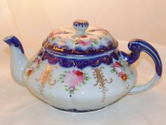 Antique Hand Painted Old Nippon Cobalt Tea Pot Asters & Roses. I have a hand painted saucer that looks like it would go with this.