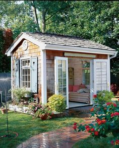 The Quaint Escape: With a cozy daybed and French doors that swing open to a charming and lush garden, this she-shed is the ultimate spot for whiling away a summer afternoon. house 17 Charming She-Sheds to Inspire Your Own Backyard Getaway Backyard Storage Sheds, Backyard Sheds, Outdoor Sheds, Shed Storage, Garden Sheds, Outdoor Storage, Diy Storage, Backyard Studio, Storage Ideas