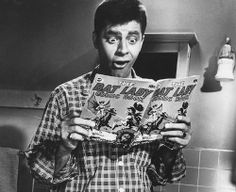 Jerry Lewis reading a comic book.