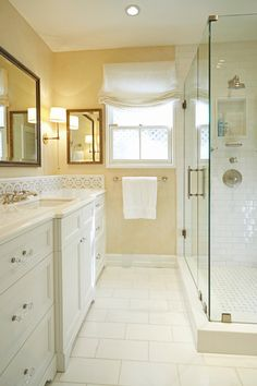 Girls bathroom renovation: Urban Electric Co. sconces, custom mirror, custom vanity, Thassos marble counter and floor, glass cabinet pulls; stone mosaic backsplash; white subway tile, handmade tile, daisy backsplash; daisy mosaic pattern, white lacquer vanity. For more inspo, check out http://www.susancorrydesign.com