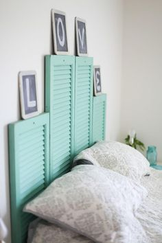Use vintage shutters in this gorgeous headboard DIY project.