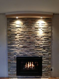 Cappella fireplace insert modern style with Placer Gold ledge stone with a soffit with lights . | Yelp