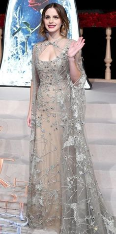 Yay or Nay? Emma Watson in a nude and white sheer embellished gown with a cape