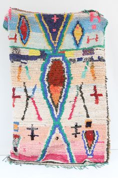 Boucherouite Rug 2 Morocco's Berber craft Boucherouite rugs. Can also be hung on walls. Authentic vintage rugs that make a c...