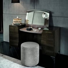 Rediscovering furnishing elements, that make special the sleeping area and interpret them leaving shapes to move free between past, present and future. The dressing table opens revealing a make-up mirror and a practical top covered with ecru nubuck fabric and illuminated by led lights.