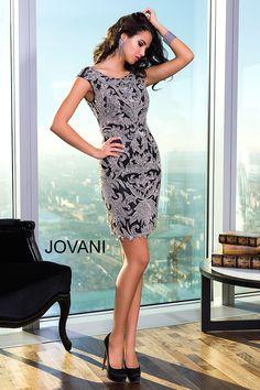 Style 98165 http://www.jovani.com/short-dresses-cocktail-dresses/black-open-back-short-dress-98165