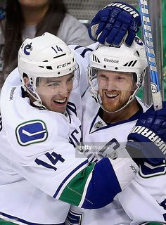 alex-burrows-and-henrik-sedin-of-the-vancouver-canucks-celebrate-a-picture-id162319250 (753×1024)