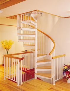 "<I>(Left)</I> <B>5' 0"" Diameter Multi-Story Metal Kit</B> with included triple in-between spindles, optional oak tread coverings, solid oak handrail, oak center pole cap, well railings with matching oak tops. <I>(Stair painted and treads and handrail stained by owner.) Independent Builders, Cadiz, KY</I><br /><br /><I>(Right)</I> Full view showing stairs and balcony and well railings with oak tops."