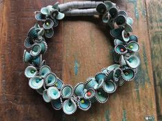 Laurel Swetnam is a polymer clay artist, in Portland Oregon, working in Millefiori cane work. She also teaches polymer clay workshops. Disc Necklace, Polymer Clay Creations, Red And Grey, Wearable Art, Bracelets, Necklaces, Fashion Accessories, Bloom, Pendants