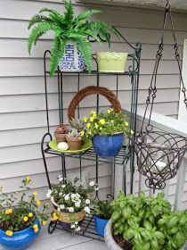 Upstairs Downstairs: Outdoor Baker's Rack ~ Three Ways Bakers Rack Decorating, Deck Decorating, Garden Shelves, Plant Shelves, Outdoor Bakers Rack, Wrought Iron Garden Furniture, Outdoor Shelves, Small Greenhouse, Greenhouse Ideas