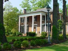 Coby Hall is an antebellum Georgian Revival former residence in Florence, Alabama.   The house was built by John Simpson on the site of his earlier home in 1843. Simpson was sent to Florence by James Jackson, builder of the Forks of Cypress, another prominent antebellum structure in the Shoals area, to buy land and to operate a mercantile business