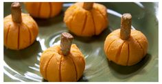 Using cold-packed cheddar cheese (the soft kind in a container), spoon out one tablespoon of cheese onto waxed paper. Roll it into a ball, and place on a plate. Use a toothpick to carve lines into the pumpkin, and place a quarter of a pretzel stick in the middle and gently press it down to slightly flatten out the pumpkins. Serve with crackers for an adorable yet healthy appetizer!