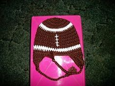 Football anyone? Crochet this adorable Football Hat for anyone in the family. This free crochet hat pattern gives instructions for newborn through 12 months. It's an easy pattern that's great to wear while watching football on TV or when you're at a game.