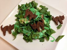 Halloween Salad: Leaves from the dark forest, poison apples, and cat croutons served with green goblin dressing