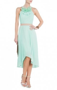 $178.00 Feel fancy and free in this pretty pleated dress that's perfect for twirling from party to party. Round halter neck. Sleeveless.Allover micro-pleating. Contrast banded waist. Ruffle embellishment at neck.High-low hem.Chiffon: Polyester.Dry Clean.Imported.