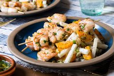 Smoky charred scallions, crunchy jicama, and sweet satsuma mandarins bring a kaleidoscope of flavors to the side in this colorful one-pan shrimp dinner. Gourmet Recipes, Healthy Recipes, Weekly Recipes, Seafood Recipes, Healthy Foods, Healthy Meals Delivered, Shrimp Skewers, Primal Kitchen, Salsa Verde