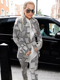 Rita Ora couldn't have looked more badass in crazy cool shield sunnies 'n' a wildly patterned ensemble!