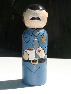 Policeman Whittle Peg Doll via Etsy.