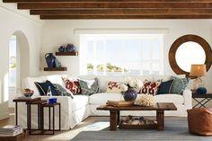 Love the wood beams and circle mirror