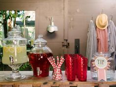 How To Host a Backyard Barbecue Wedding Shower: Once your do-it-yourself lemonade-stand drink station is in place, stock the plywood countertop with clear glass beverage servers filled with lemonade, iced tea and/or signature juices as well as color-coordinated glasses and even a tip jar to gather money for the couple's honeymoon fund. From DIYnetwork.com